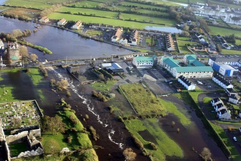 Flooding in Claregalway on the lower River Clare in November 2009. Building on the floodplain here (see old bridge on right of photo), and the arterial drainage scheme which aimed to rush water downstream as fast as possible, did not help matters here. The current plan is to deepen and widen the river upstream from here even further – should we not be looking to restore the old turloughs and floodplains instead?